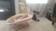 Mum's parenting hack using a KitchenAid to rock a baby's bouncer has divided the Internet