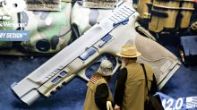 Cops, Priests UrgeSmith & Wesson to Make Guns Safer