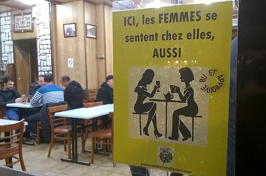 "A poster by a feminist group in a Paris bar reads ""here, women feel at home too"" (AFP Photo/Julian Colling, Sarah Brethes)"