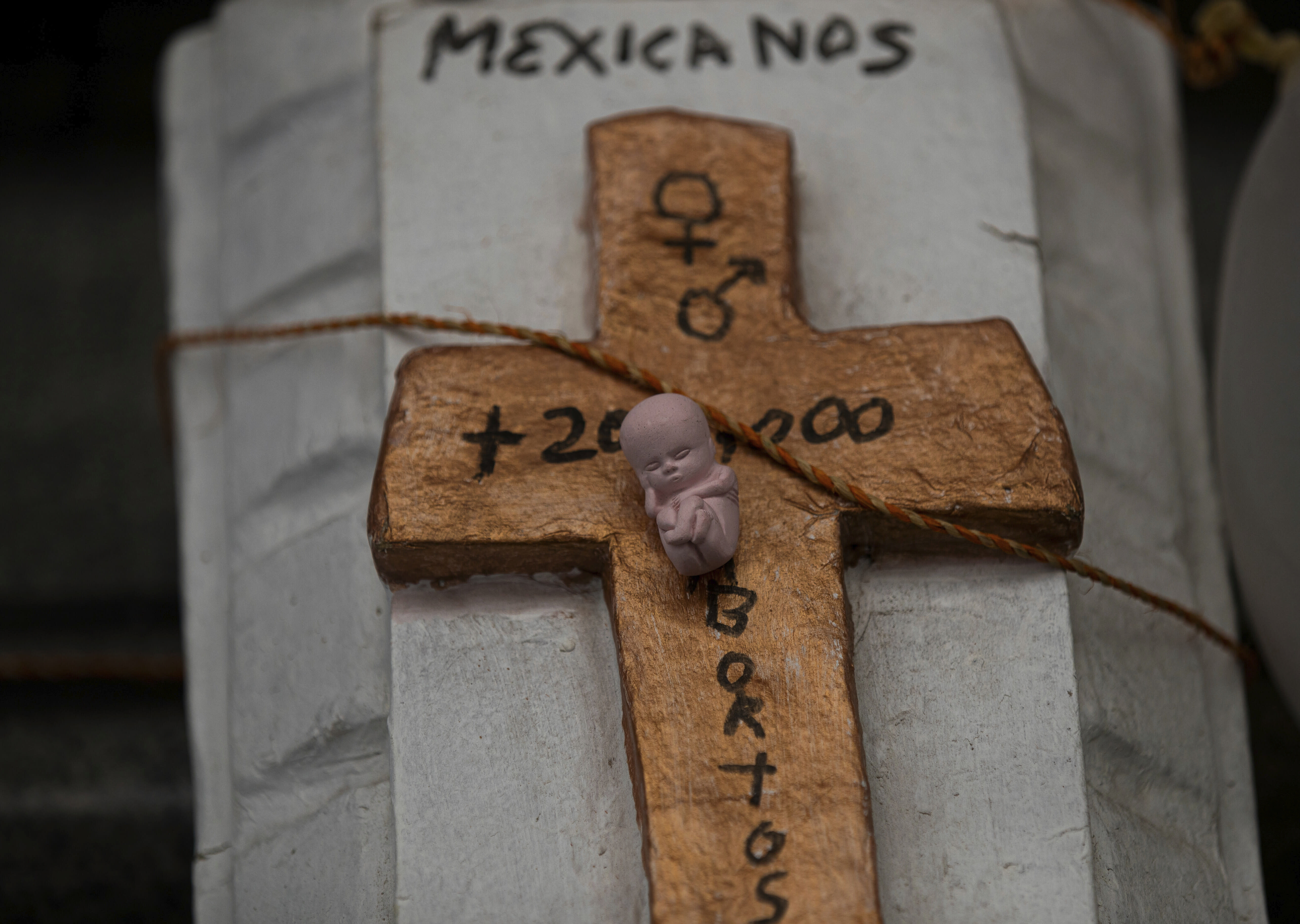 A mock coffin featuring a cross and tiny statue fo a fetus lays outside the Supreme Court that ruled against an injunction in Veracruz state aiming to decriminalize abortion for all cases within the first 12 weeks of pregnancy, in Mexico City, Wednesday, July 29, 2020. Two of Mexico's 32 states have decriminalized abortion. (AP Photo/Fernando Llano)