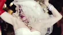 Still like a virgin: Madonna rocks another wedding gown in sexy new 'Medellín' video