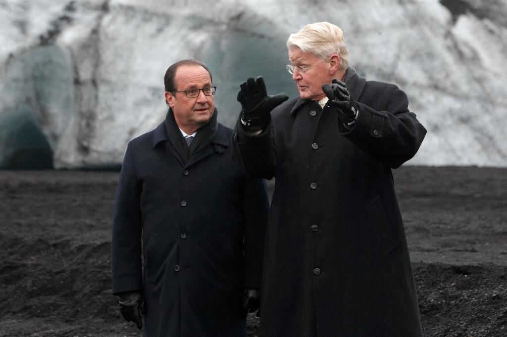 Iceland's President Olafur Ragnar Grimsson showed French President Francois Hollande the Solheimajokull glacier in October, ahead of the UN climate summit, providing a vivid example of ice having retreated by more than 1 kilometre (AFP Photo/Thibault Camus)