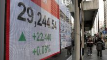 Global stock markets drop after Fed rate hike