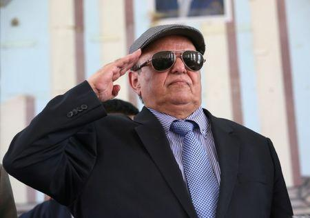 Yemen's President Abd-Rabbu Mansour Hadi salutes during a visit to the country's northern province of Marib