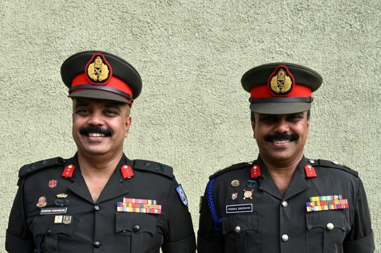 Twin Sri Lankan army generals Jayantha (L) and Pooraka (R) Seneviratne were among the thousands who turned up for the record attempt (AFP Photo/LAKRUWAN WANNIARACHCHI)