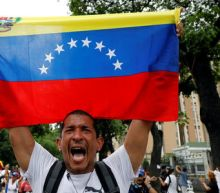Venezuela opposition march to honor those killed in violence