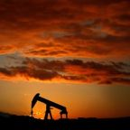 Oil climbs over $1/bbl on U.S.-China trade deal hopes, Mideast tension