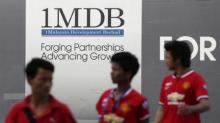 Singapore's central bank fines Credit Suisse, UOB over 1MDB-linked transactions