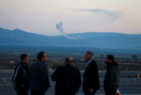 Smoke rises from the Syria's Afrin region, as it is pictured from near the Turkish town of Hassa, on the Turkish-Syrian border in Hatay province, Turkey January 20, 2018. REUTERS/Osman Orsal