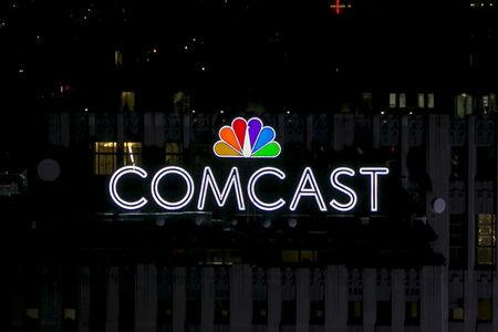 The NBC and Comcast logo are displayed on top of 30 Rockefeller Plaza, formerly known as the GE building, in midtown Manhattan in New York