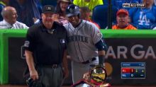 Nelson Cruz pulls out his phone and takes a photo with umpire before All-Star game at-bat