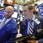 Stocks hit new highs, shake off trade fears