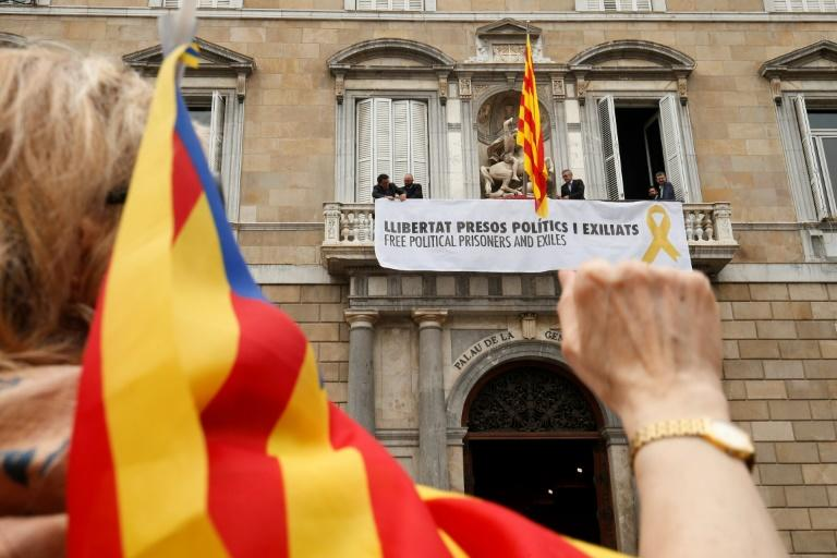 "Seen here hanging on the Catalan government building, the offending banner reads ""Free political prisoners and those in exile"""