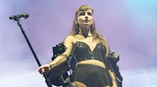 Singer Lauren Mayberry hits back at critics who claim her stage outfits are 'too revealing'