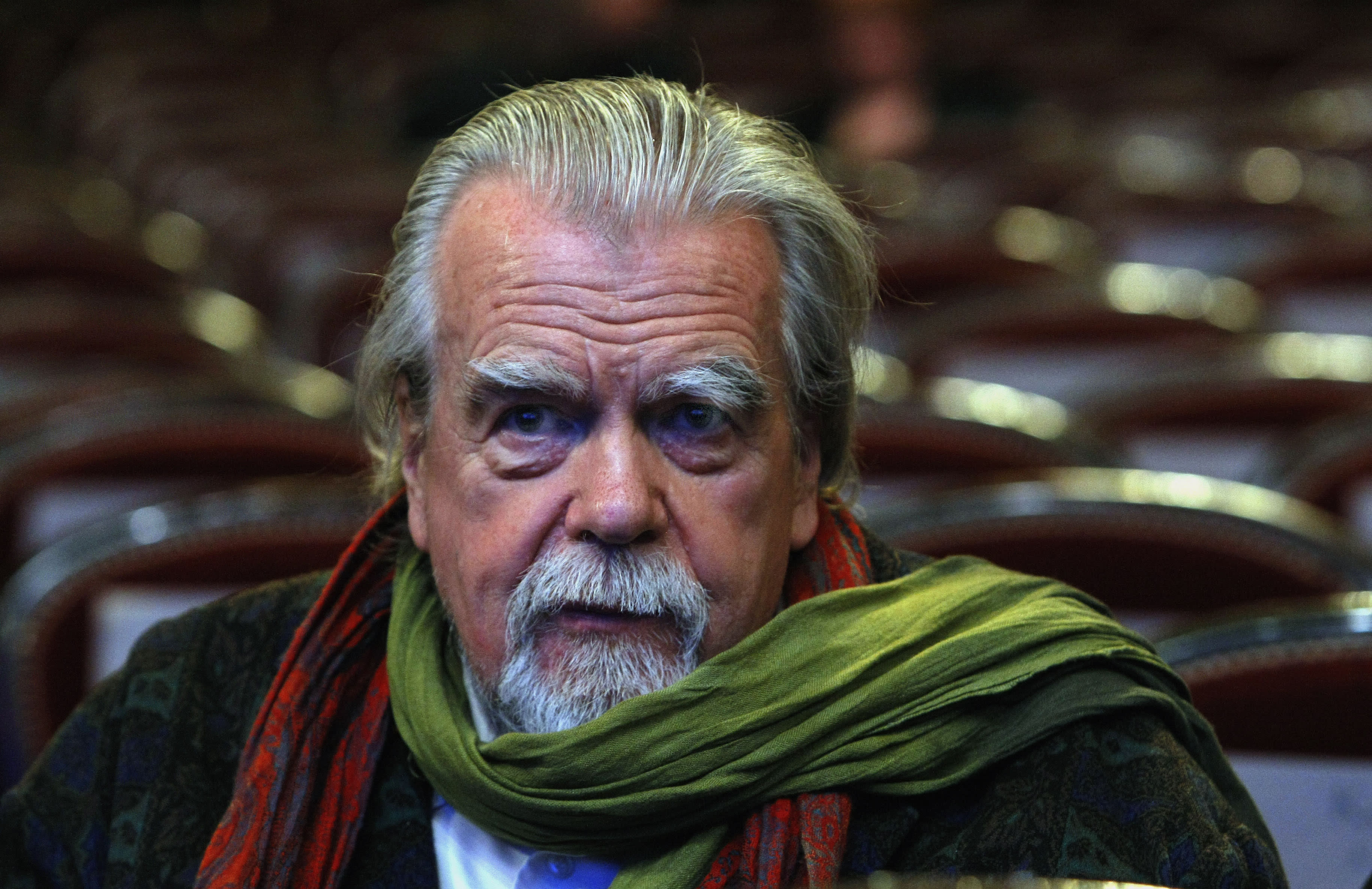 "FILE - In this Feb.25, 2011 file photo , French actor Michael Lonsdale, awarded for the Supporting Actor, attends prior to the annual Cesar 36th Awards ceremony, in Paris. Michael Lonsdale, a French-British actor and giant of the silver screen and theatre in France, died on Monday, his agent said. From his role as villain in the 1979 James Bond film ""Moonraker"" to that of a monk in Algeria in ""Of Gods and Men,"" Lonsdale worked, often in second roles, with top directors from Orson Wells to Spielberg. (AP Photo/Jacques Brinon, File)"