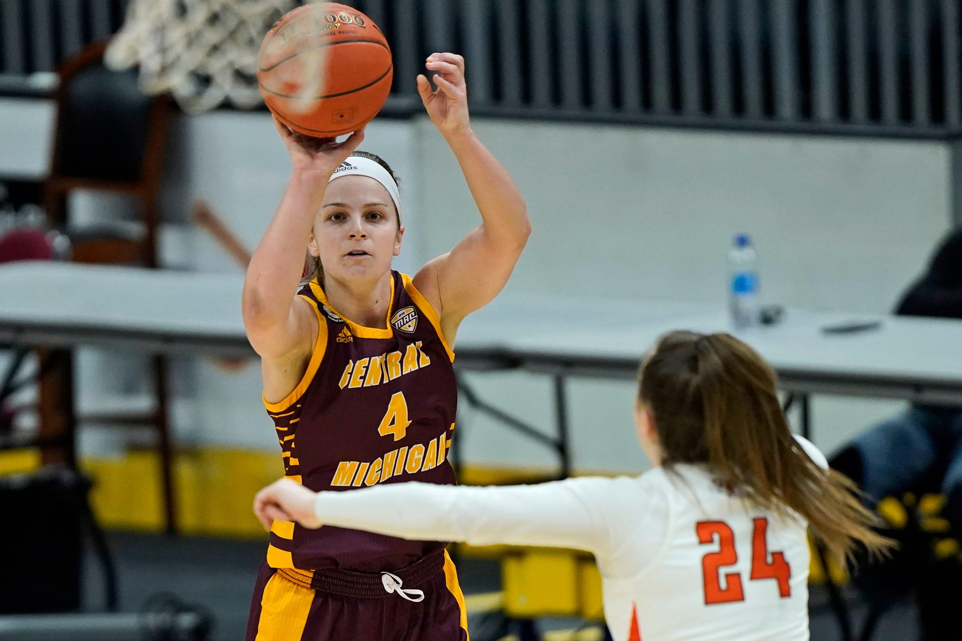 Central Michigan's Maddy Watters shoots over Bowling Green's Kenzie Lewis during the first half of CMU's 77-72 win in the MAC tournament final on Saturday, March 13, 2021, in Cleveland.
