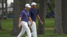 The Latest: Mickelson starts with 2 birdies, cools quickly
