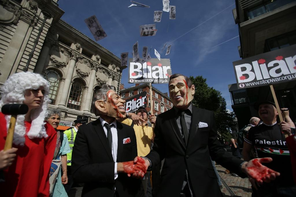 Demonstrators wear masks depicting former British prime minister Tony Blair (L) and former US president George W. Bush, during a protest in London as they wait to hear the outcome of the Iraq Inquiry (AFP Photo/Daniel Leal-Olivas)