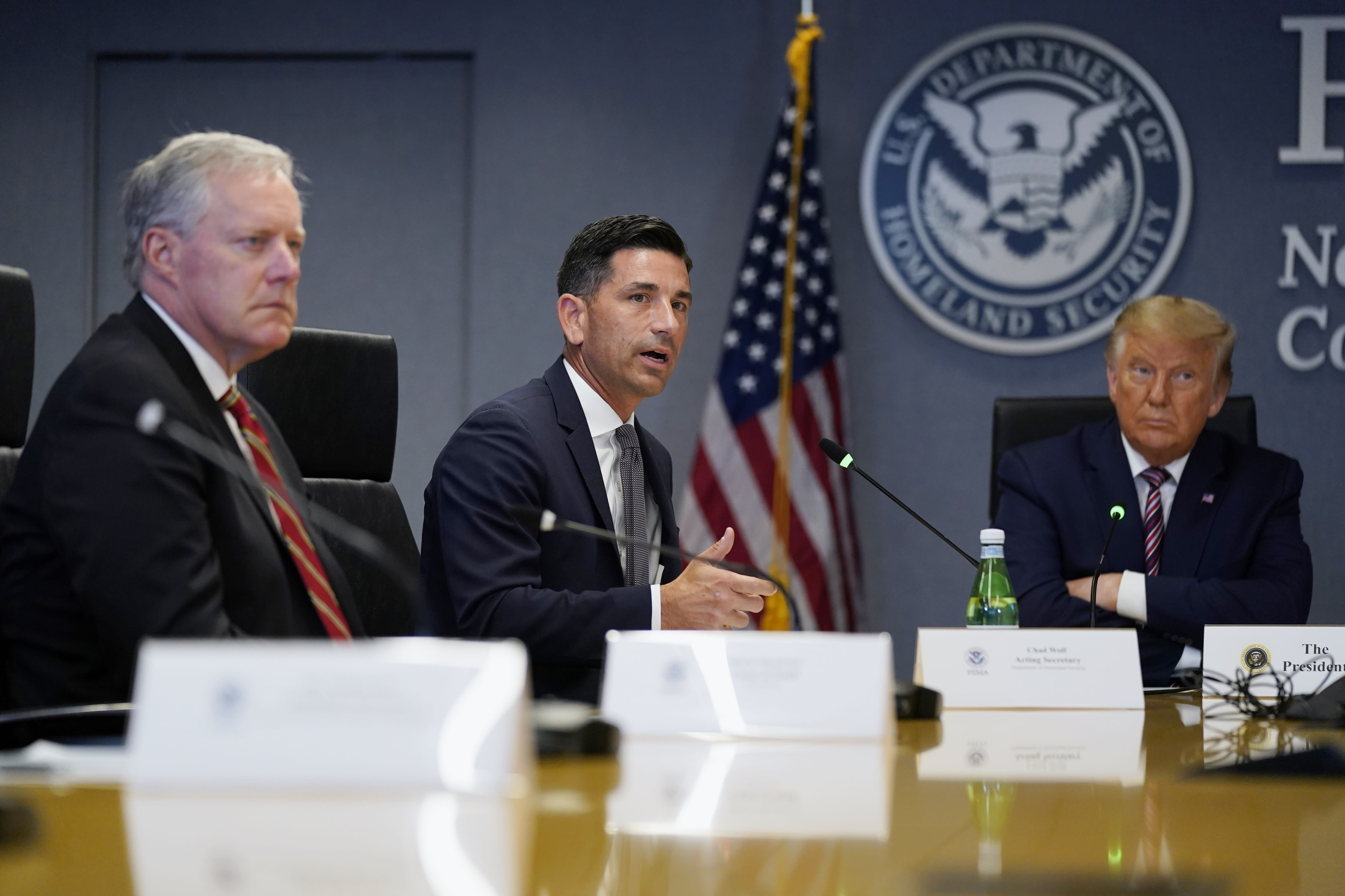 White House chief of staff Mark Meadows, left, and President Donald Trump listen as Acting Secretary of Homeland Security Chad Wolf speaks during a Hurricane Laura briefing at FEMA headquarters, Thursday, Aug. 27, 2020, in Washington. (AP Photo/Evan Vucci)