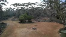 Woman rescued after drawing SOS message in Australian wilderness