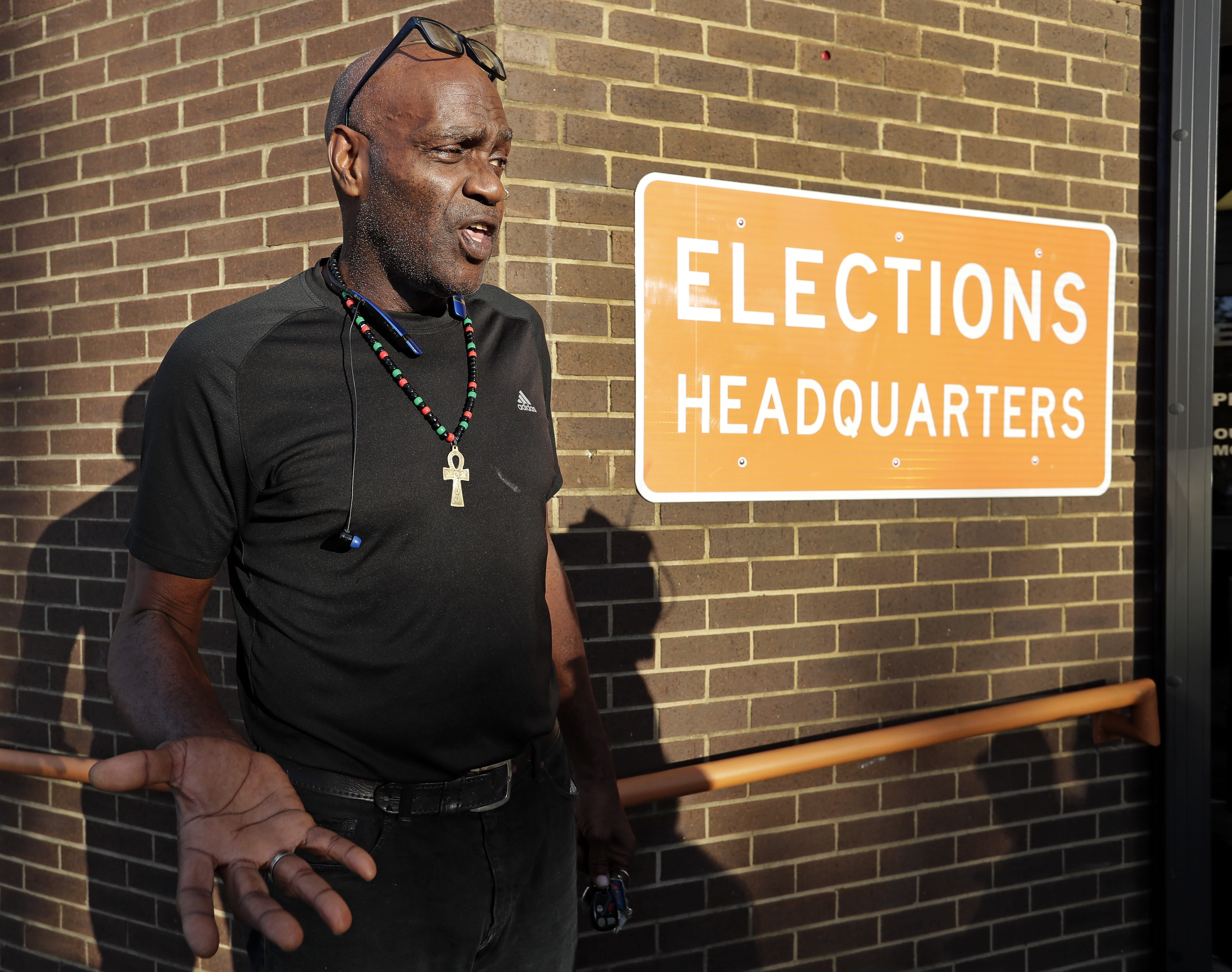 CORRECTS LAST NAME TO ECKFORD NOT ECKERD - Former felon Robert Eckford talks with reporters after registering to vote at the Supervisor of Elections office Tuesday, Jan. 8, 2019, in Orlando, Fla. Former felons in Florida began registering for elections on Tuesday, when an amendment that restores their voting rights went into effect. (AP Photo/John Raoux)
