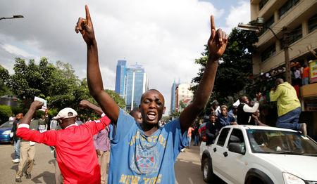 Kenyan opposition Coalition of Reform and Democracy (CORD) supporters protest at the premises hosting the headquarters of Independent Electoral and Boundaries Commission (IEBC) to demand the disbandment of the electoral body ahead of next year's election in Nairobi, Kenya, May 23, 2016. REUTERS/Thomas Mukoya