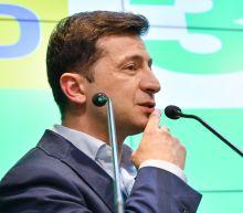 Ukraine's Zelensky urges Russia sanctions after citizenship rule change