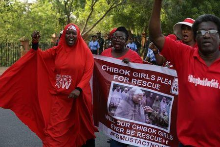 Campaigners from the #BringBackOurGirls group protest in Nigeria's capital Abuja to mark 1,000 days since over 200 schoolgirls were kidnapped from their secondary school in Chibok by Islamist sect Boko Haram, Nigeria January 8, 2017. REUTERS/Afolabi Sotunde/Files