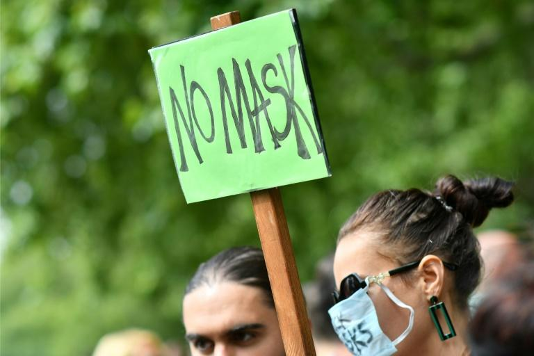 Dozens gathered in London to protest the face mask requirement in England's shops and supermarkets