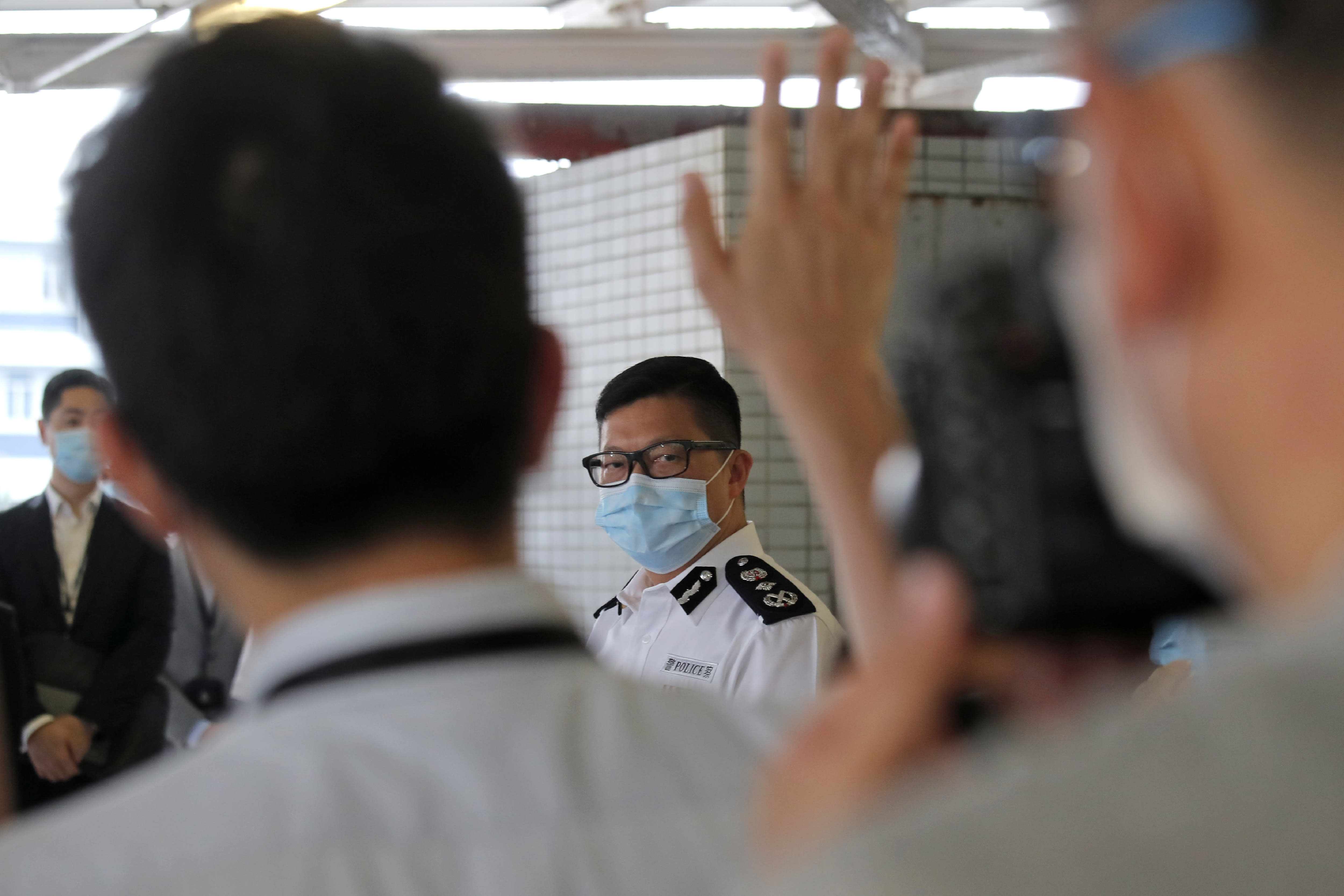 The Commissioner of Police Chris Tang Ping-keung speaks to the media at the Police Marine Regional Headquarters in Hong Kong, Thursday, Aug. 27, 2020. Chinese authorities have arrested at least 10 people, including a Hong Kong pro-democracy activist, after its coast guard intercepted a speedboat suspected of illegally crossing the border waters off the coast of the southern province of Guangdong. (AP Photo/Kin Cheung)