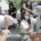 Meghan Markle volunteers in L.A. wearing a stylish face mask