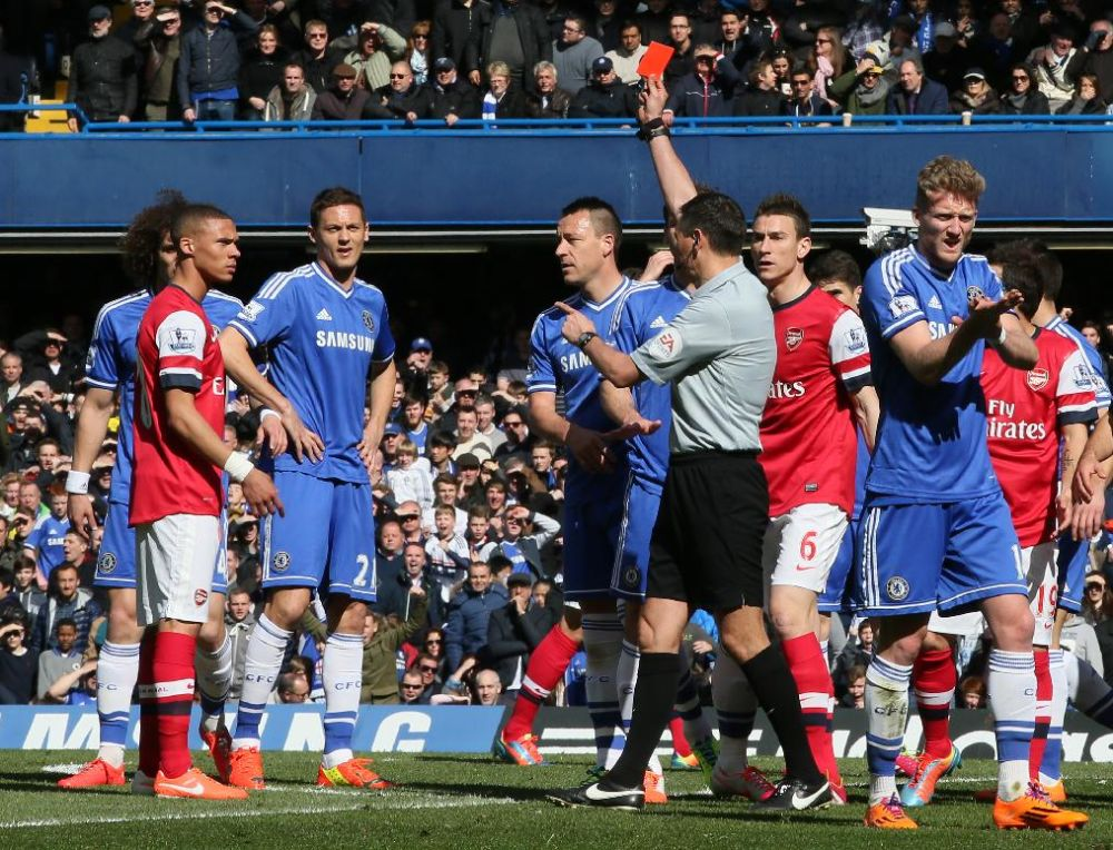 Referee Andre Marriner, in grey, sends off Arsenal's Kieran Gibbs, left, during their English Premier League soccer match between Chelsea and Arsenal at Stamford Bridge stadium in London Saturday, March 22  2014
