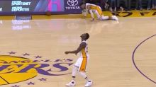 Video: D'Angelo Russell walks the dog off his feet and trips out of bounds