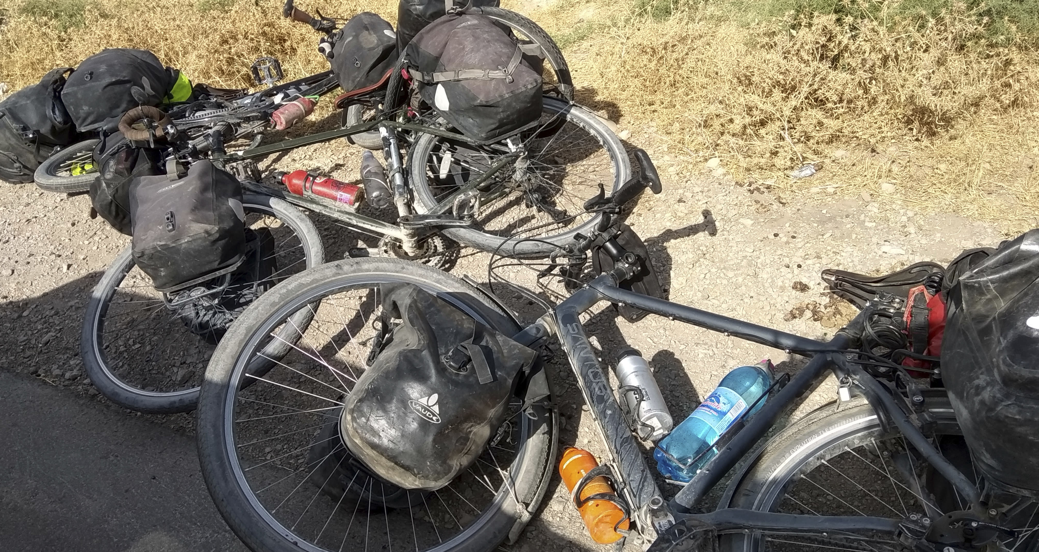 In this photo taken on Sunday, July 29, 2018, cycles are left where four tourists were killed when a car rammed into a group of foreigners on bicycles south of the capital of Dushanbe, Tajikistan. The Islamic State group on Tuesday claimed responsibility for a car-and-knife attack on Western tourists cycling in Tajikistan that killed two Americans and two Europeans. (AP Photo/Zuly Rahmatova)