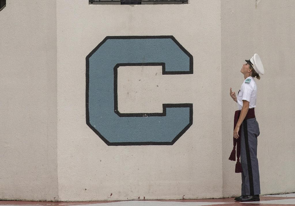 The Citadel, a prestigious military college in Charleston, South Carolina, has suspended eight students and launched an investigation after photos emerged of cadets posing in all-white outfits reminiscent of the Ku Klux Klan