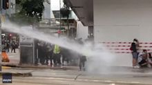 Journalists Hit by Water Cannon, Protesters Arrested, During Hong Kong Demonstration