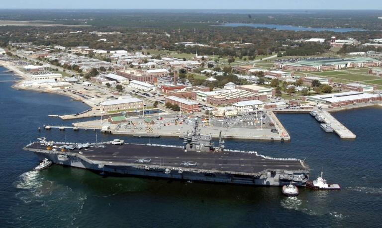 Federal Bureau of Investigation says US Navy base shooting was act of terror