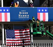 Signs declaring Biden next president go up right outside Trump's window