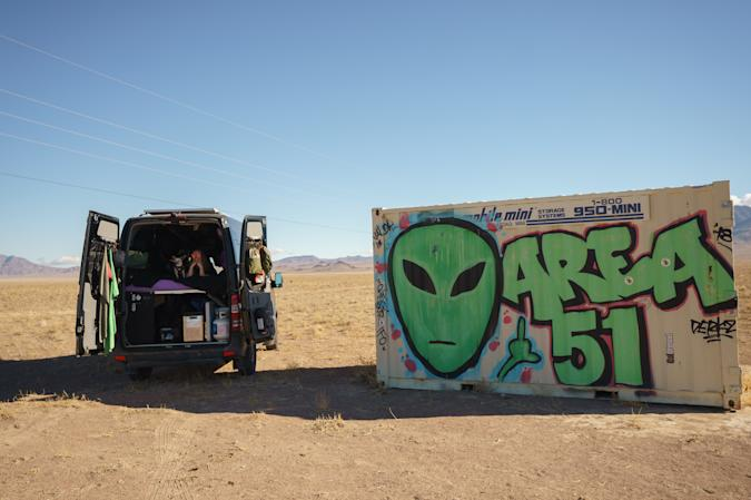 ALAMO, NEVADA - JANUARY 24: 'Vanlifer' Mary Alice Sandberg poses for a photo in a converted Sprinter Campervan next to Area 51 graffiti on January 24, 2021 in Alamo, Nevada. (Photo by Josh Brasted/Getty Images)