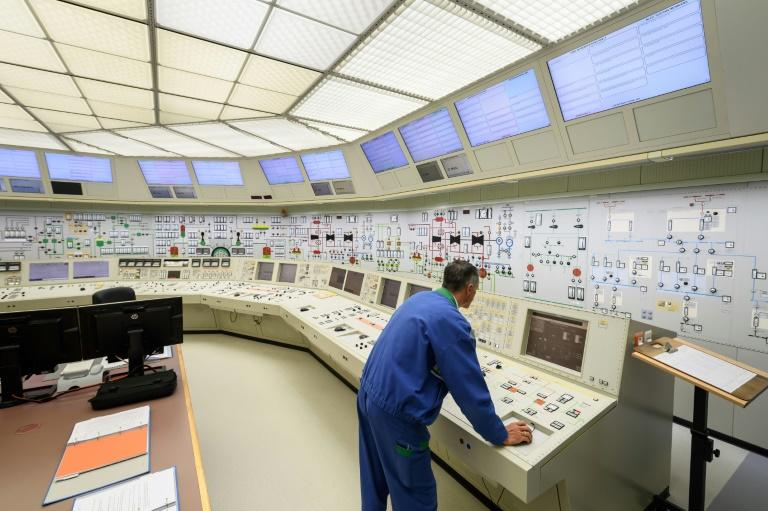 The command centre's large control panels and colourful buttons are reminiscent of the 1960s (AFP Photo/Fabrice COFFRINI)