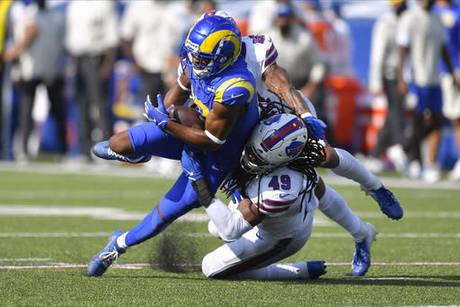 Los Angeles Rams' Robert Woods, left, is tackled b Buffalo Bills' Tremaine Edmunds, right, during the second half of an NFL football game Sunday, Aug. 26, 2018, in Orchard Park, N.Y. (AP Photo/Adrian Kraus)