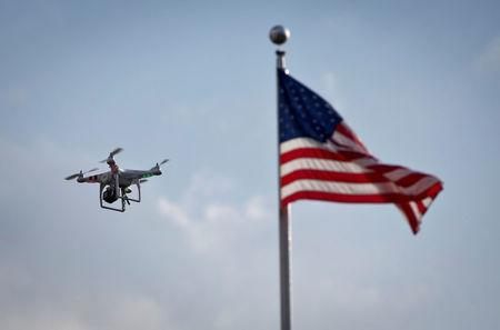 FILE PHOTO: A small drone helicopter flies over Coney Island in New York, U.S., August 29, 2013. REUTERS/Carlo Allegri/File Photo
