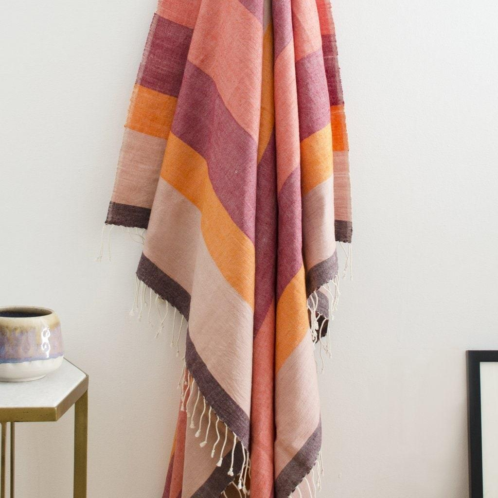 """Reminiscent of a late summer sunset, the appropriately named Afar Throw in Dusk from Bolé Road Textiles is made of 100% Ethiopian cotton and is so thoughtfully designed that it can also double as a shawl for chilly evenings outdoors. $160, Bole Road Textiles. <a href=""""https://boleroadtextiles.com/collections/throws/products/afar-throw-dusk"""" rel=""""nofollow noopener"""" target=""""_blank"""" data-ylk=""""slk:Get it now!"""" class=""""link rapid-noclick-resp"""">Get it now!</a>"""