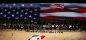 Players, coaches and staff kneel during the national anthem before an NBA basketball game between the Houston Rockets and the Portland Trail Blazers. (AP)