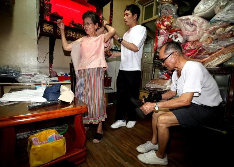 Grandson Reef Chang, 31, hit upon the idea of using the clothes to alleviate the couple's boredom (AFP Photo/HSU Tsun-hsu)