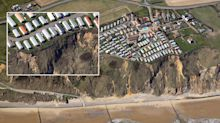 Seaside caravans left balancing on cliff after landslide 'the size of two football pitches'
