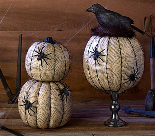 """<p>Try layering old newspaper on your pumpkin with <a href=""""https://www.michaels.com/mod-podge-matte/M10047539.html"""" rel=""""nofollow noopener"""" target=""""_blank"""" data-ylk=""""slk:Mod Podge"""" class=""""link rapid-noclick-resp"""">Mod Podge</a>. Once it dries, line the ridges with a black Sharpie, and glue on some spooky plastic spiders. <i>(Photo: <a href=""""http://dakotacreekchic.com/pumpkin-decorating-ideas-for-halloween/"""" rel=""""nofollow noopener"""" target=""""_blank"""" data-ylk=""""slk:dakotacreekchic"""" class=""""link rapid-noclick-resp"""">dakotacreekchic</a>)</i></p>"""