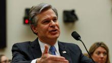 China coerces hundreds of Chinese-born critics in U.S. to return home, FBI chief says