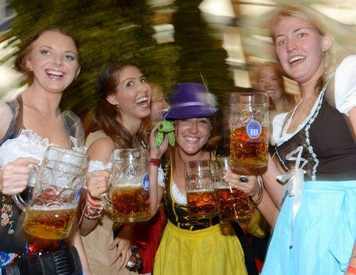 Young women celebrate Oktoberfest in Munich on September 22. The world's largest beer festival opened with a pop Saturday as the first keg was tapped at Munich's Oktoberfest, a 16-day extravaganza of lederhosen, oompah music and millions of ales