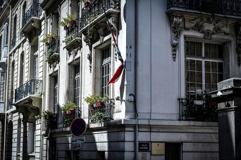 The Lebanese national flag flies at half-mast at the Lebanon embassy in Paris after a powerful explosion tore through the capital city Beirut (AFP Photo/STEPHANE DE SAKUTIN)